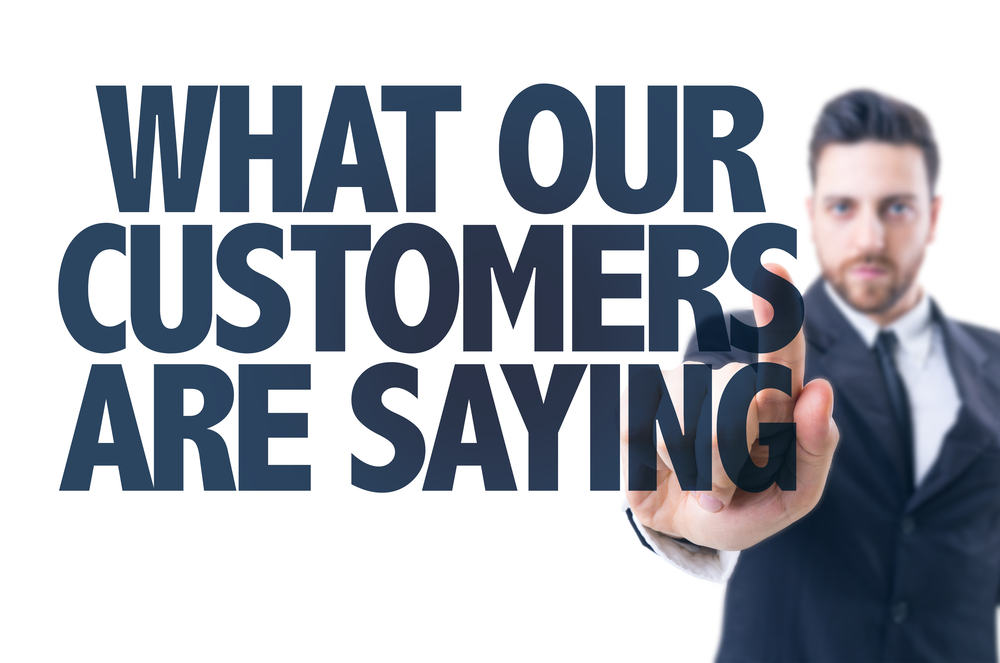 Business man pointing the text What Our Customers Are Saying