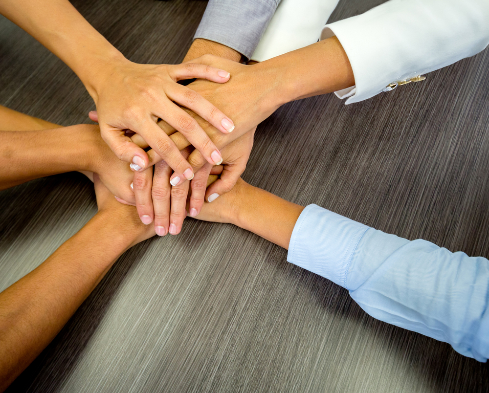 Business team in a meeting with their hands together-1