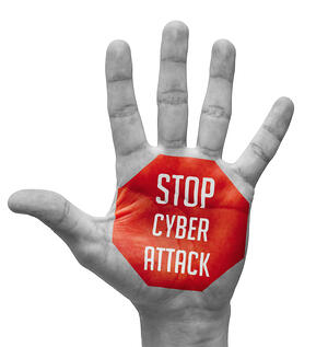 Stop Cyber Attack Sign in Red Polygon on Pale Bare Hand. Isolated on White Background.