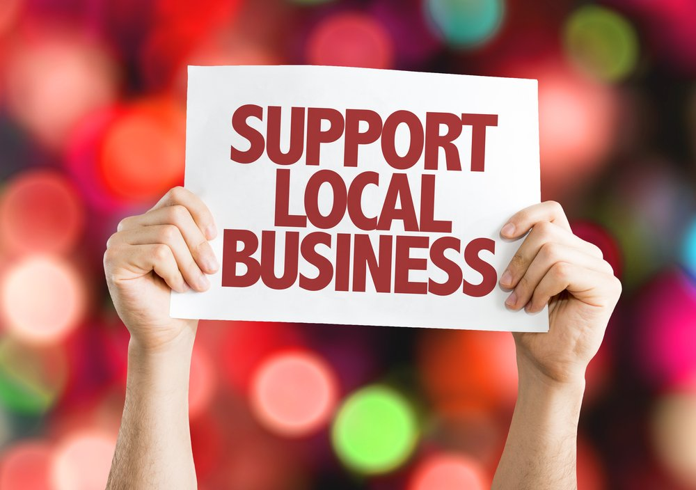 Support Local Business placard with bokeh background